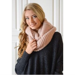 Chunky pink knit infinity scarf.